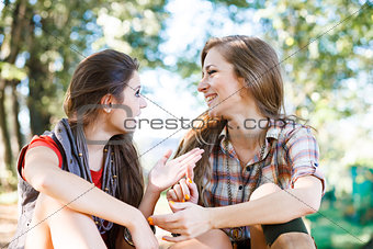 two girlfriends outdoor talking