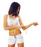 caucasian woman measures her waist