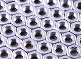 Nuts of bolts as a background