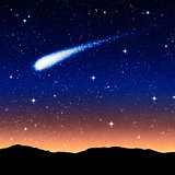 starry sky at night with comet or shooting star