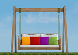 Wooden swing on grass