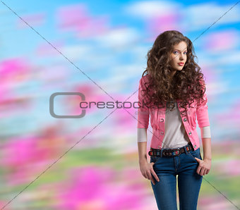 wavy brunette with yellow jacket and hands in the pockets
