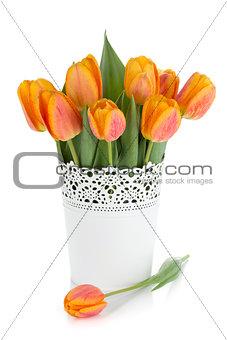 Orange tulips in flowerpot
