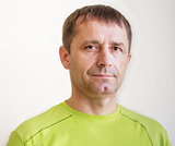 Portrait Of Casual Smiling Man In Green T-Shirt