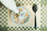 Muesli breakfast in package.Bottle milk and spoon