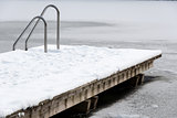 Pool ladder on a frozen lake