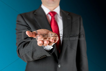 Business man outstretching hand