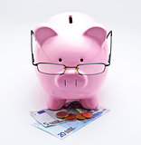 Piggy bank with glasses on Euros