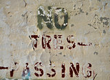 no trespassing peeling sign