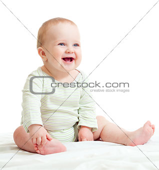 Baby boy isolated sitting smilingly