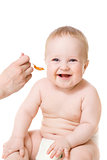 smiley baby boy  feeding isolated on white