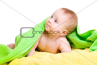 Adorable baby in green towel looking up