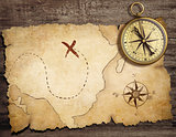 aged brass antique nautical compass on table with old treasure m