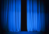 blue stage curtain slightly open 
