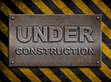 &quot;under construction&quot; metal plate  over hazard stripes