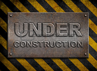 """under construction"" metal plate  over hazard stripes"