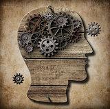 Human brain work metaphor made of rusty metal gears