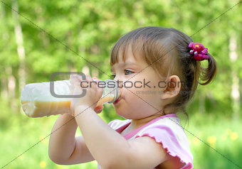 Little girl portrait drinking milk beverage