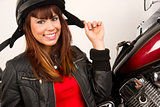 Beautiful Brunette Biker Holding Helmet Straps