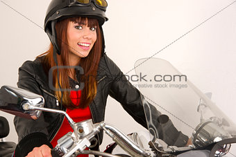 Beautiful Brunette Biker Holding the Handlebars