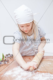 Young girl making gingerbread