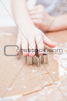 Cutting gingerbread shapes from dough