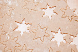 Gingerbread dough with star shapes