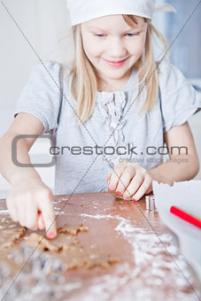 Young girl pointing to gingerbread shape