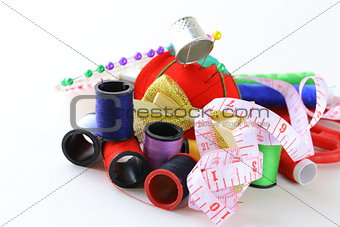 sewing utensils - coils colored threads, pins, thimble