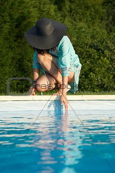 touching water on swimming pool