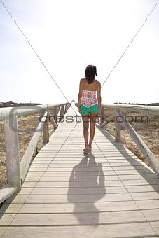 walking on wooden lonely footbridge