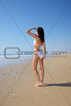 white bikini woman watching far