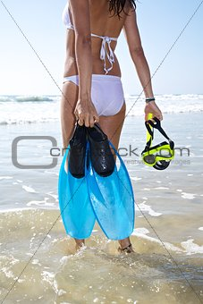 white bikini woman with flippers and goggles