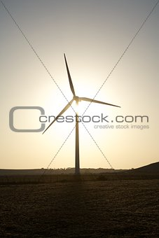wind turbine against sun