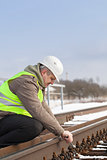 Railroad worker with adjustable wrench fix the nut
