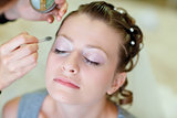 girl applying make-up