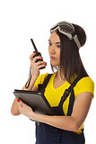 Woman with cb radio and tablet computer, portrait.