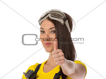 A female construction worker holding an up signal - isolated.