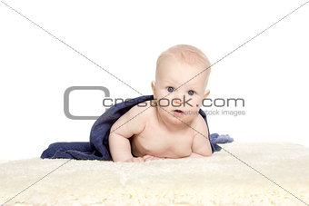 Adorable happy baby in colorful towel on white background