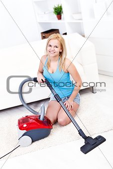 Sexi woman using vacuum cleaner