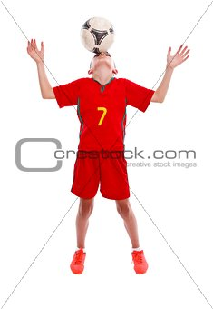 Young soccer boy making trick