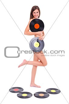 Nude girl with vinyl discs