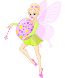 Fairy flying with Easter egg