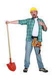 Laughing man with shovel