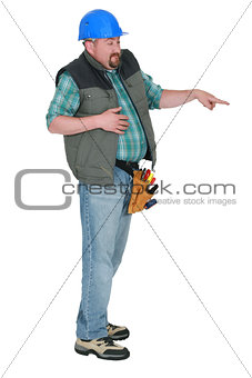 Nervous construction worker pointing