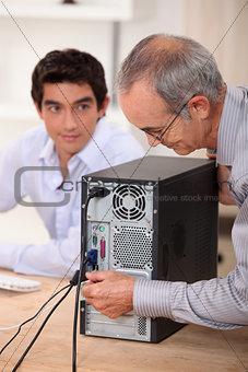 senior technician repairing computer