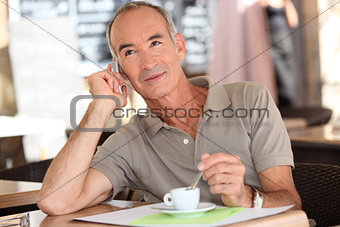 Man on the phone having coffee