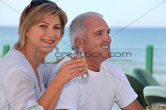 Couple drinking beer in beach terrace
