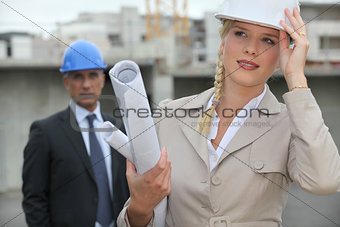 Female architect on site holding her hard hat