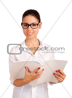Smiling business woman holding magazine